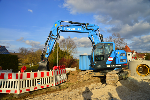 Neureiter uses the HX235LCR 25 metric ton short tail excavator mainly for heavy-duty canal and below ground construction.